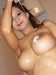 Big tit Thai babe Janee takes a sudsy bath and fucks