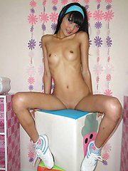 Incredibly skinny Thai teen Eaw strips for us in her bedroom