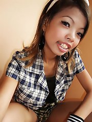 Slender cutie from Bangkok sips pop from a straw and takes pics