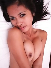 Slender young Asian with great tits gets undressed