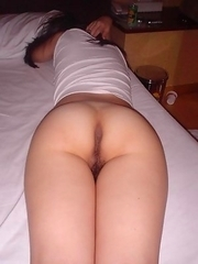 Korean honey displays her ass and hairy cunt