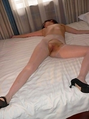Skanky Chinese slut posing in her pantyhose